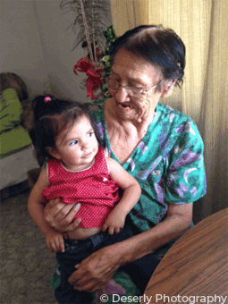 grandmother holding small child